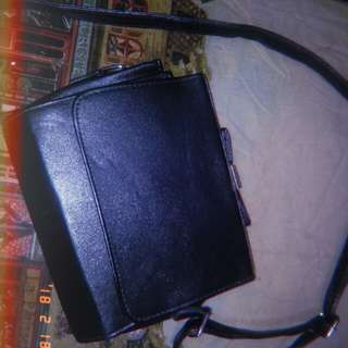 Black sling bag with ribbon on top
