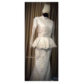 lace peplum with mermaid skirt in lace. Made to order to custom measurements with matching veil.
