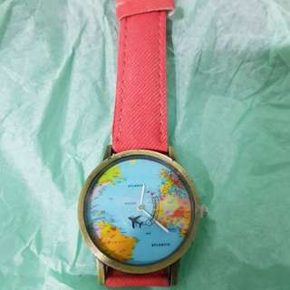 Globe and coloured woman watches