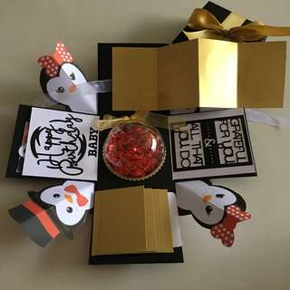 Penguin explosion Box With Globe Ornament , 4 Waterfall . Pull tab in black , white & gold