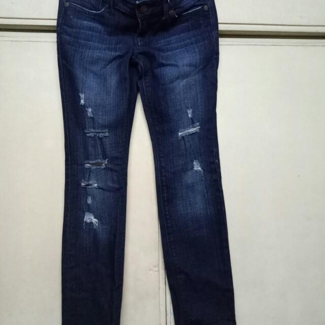 branded tatrered pants