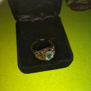 Light blue stone. Sterling silver size 7. Need 2clean