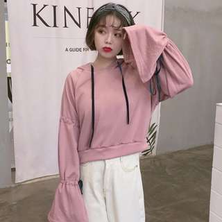 Pink pullover with bell sleeves