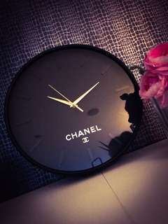 Brand new black chanel clock with gold features