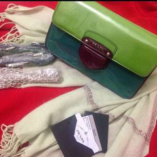 Authenthic Prada patent clutch and cross body bag