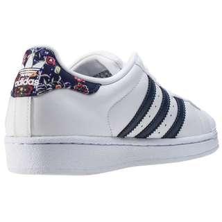 Adidas Superstar in white/navy/floral