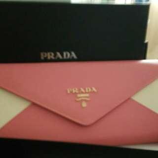 Prada 2 tone clutch bag with chain