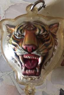 Tiger's head amulet with singha .