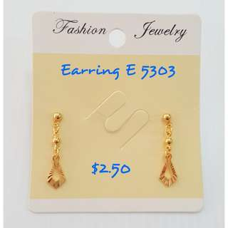 Dangling gold plating earrings.
