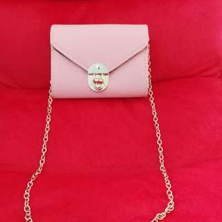 Pink bag with gold chain