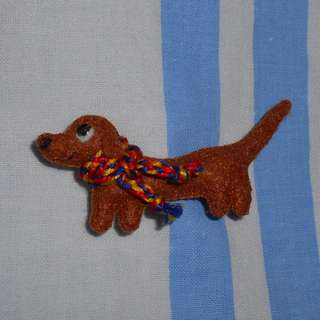 Dachshund pin/brooch with hand-woven red, blue and yellow scarf