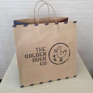 The Golden Duck Co paper bag