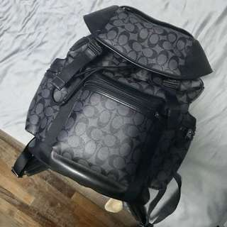 Coach monogram buckled bagpack