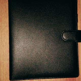 binder hitam