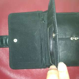 Used black Fossil wallet for women.