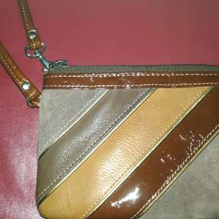 Barely used brown Fossil wristlet.