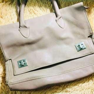 beige hand bag