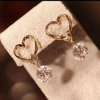 BN Heart earring free postage