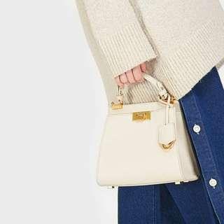 Charles & Keith push lock handbag
