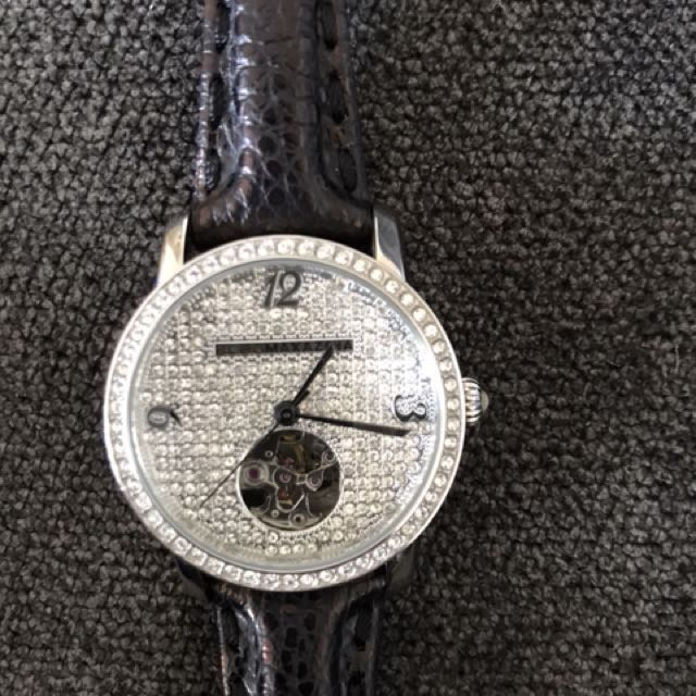 BCBG rhinestone watch with black leather band.