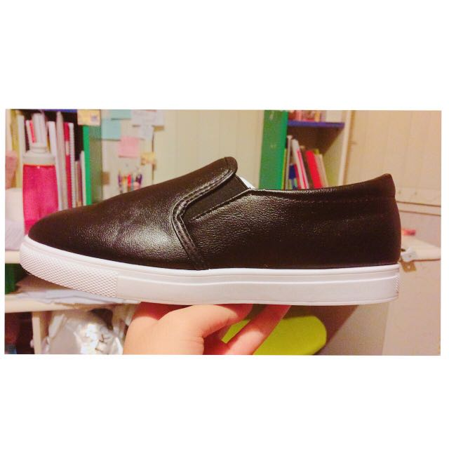 Black leather faux slip ons