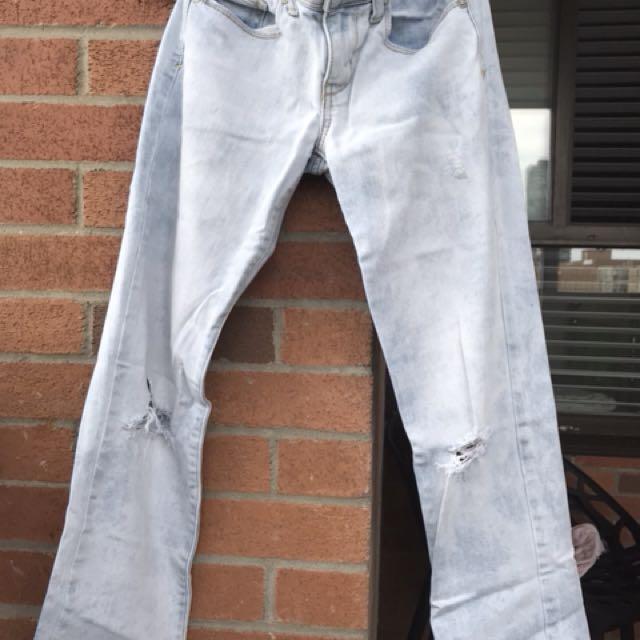Light blue distressed jeans . Size 4