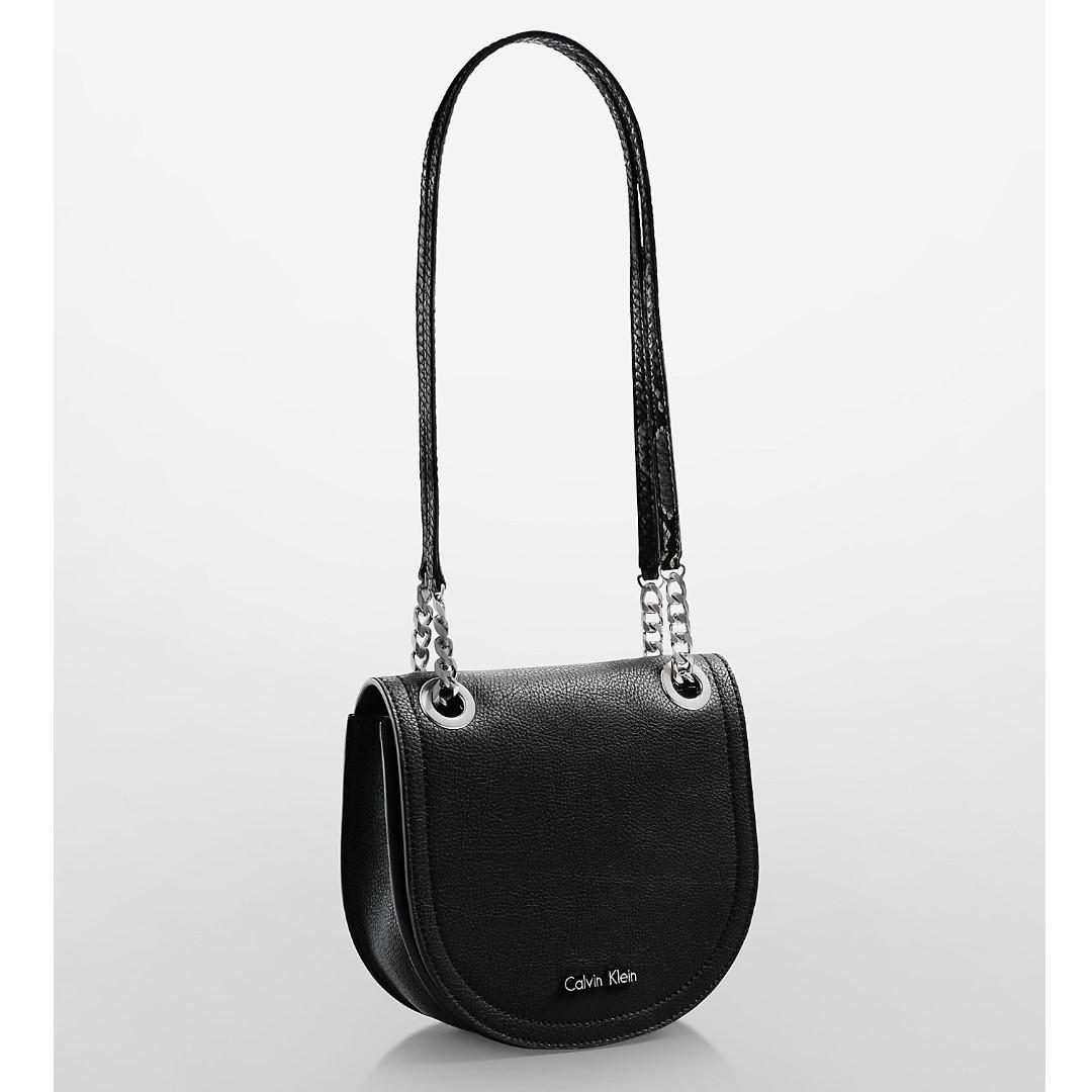 bec3628a0b New Calvin Klein Women's Kira Studio Saddle Crossbody and Shoulder Handbag  Bag (Black Faux Leather), Women's Fashion, Bags & Wallets on Carousell