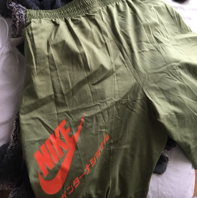 Olive green Nike pants