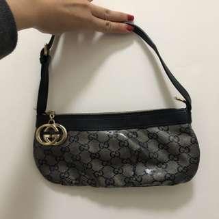Gucci small pouch bag