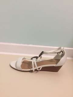 White sandals with brown beads