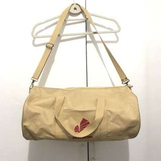 Cream duffle bag