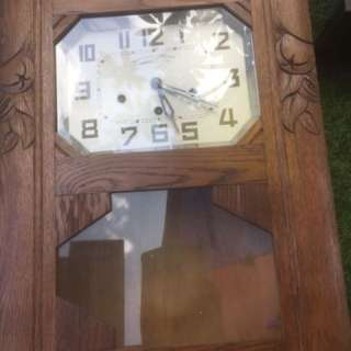 An used 3 holes wall clock