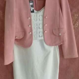 Pink blazer and white dress.