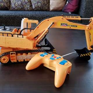 Remote backhoe construction truck