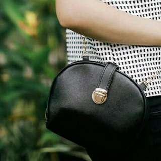 Tas round sling bag