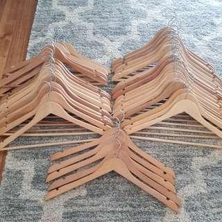 43 wooden coat hangers