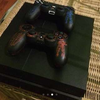 Playstation 4 with 5 digital games and two controllers