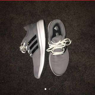 Grey and white adidas shoes