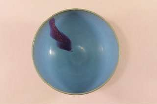 A ceramic bowl with blue and purple jun Yao