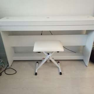Compact electronic white piano