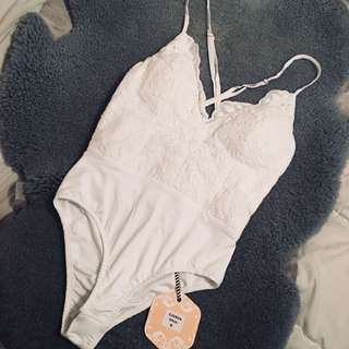 Laced white bodysuit