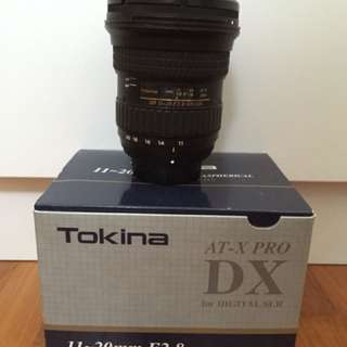 Tokina 11-16mm F2.8- as new condition. Purchased new at Cathay Photo with Kenko UV filter for $967.