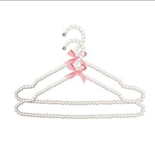 Wedding gown hanger with pearls