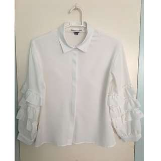 White blouse with ruffled sleeves