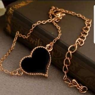 Dara Black Heart Bracelet with Gold outline