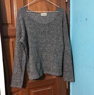 Grey long sleeved knitwear
