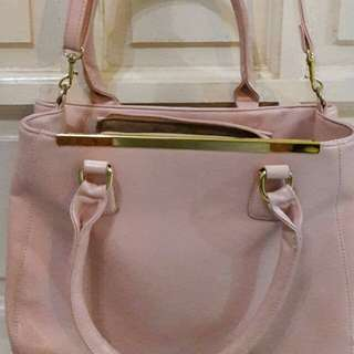 Pink sling bag with handles