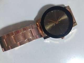 Rose gold metallic watch