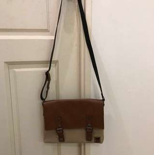 Handmade synthetic leather and fabric sling bag