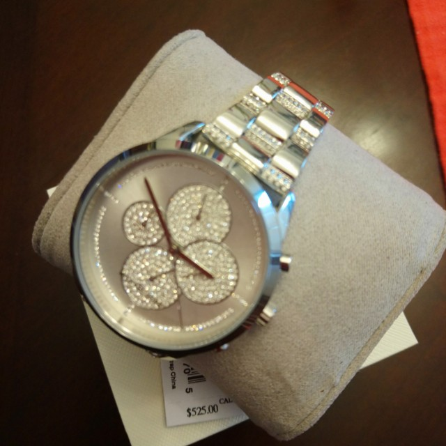 Michael Kors watch. Brand new. Price in store about $600. Still with the tag